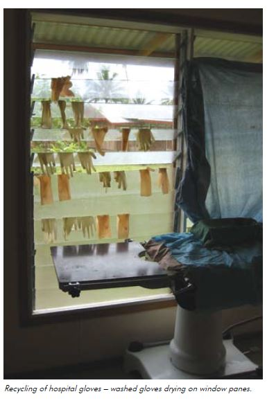 Recycling of hospital gloves – washed gloves drying on window panes.